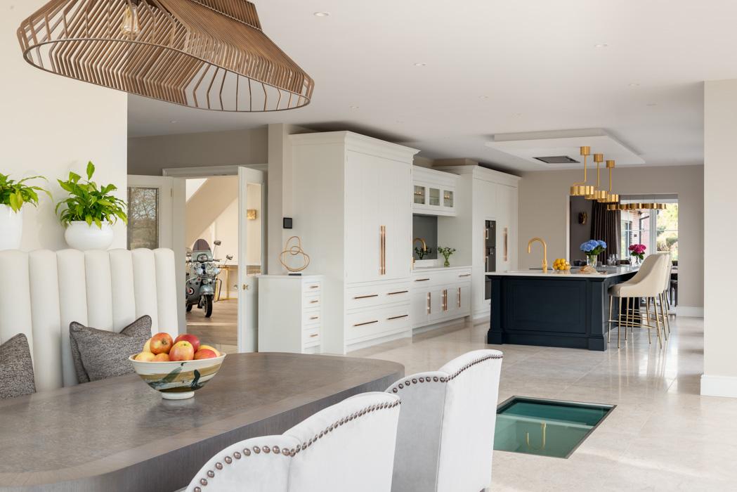 side angle of harriet hughes design modern white kitchen