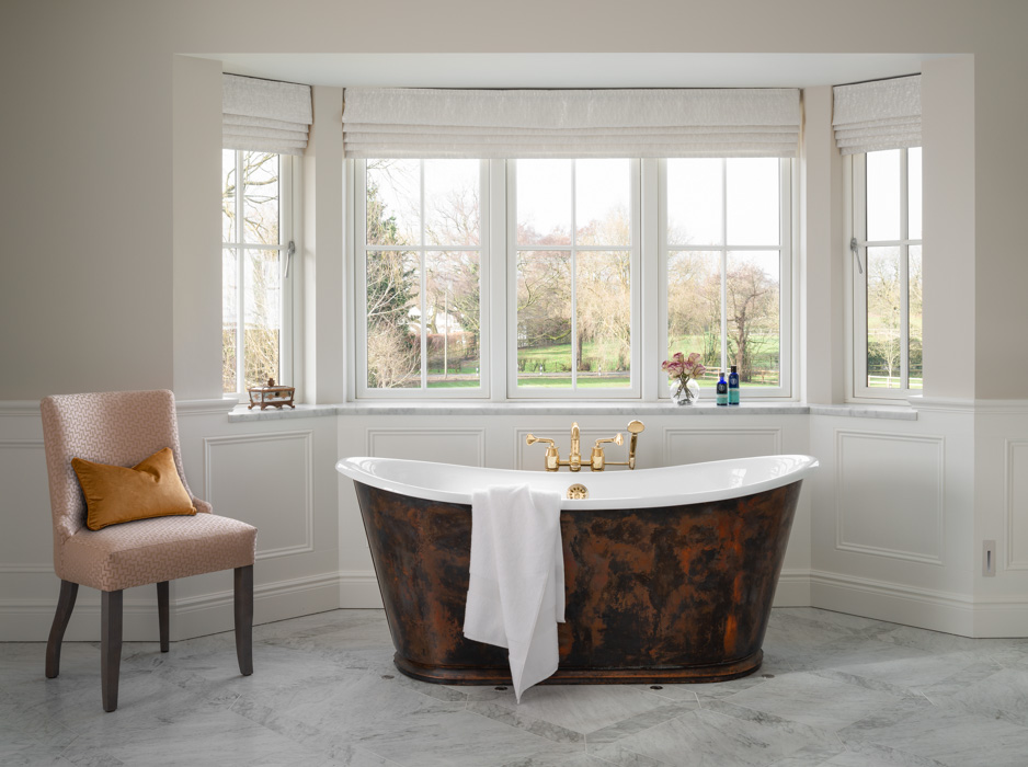 one point harriet hughes marble bathroom with window view