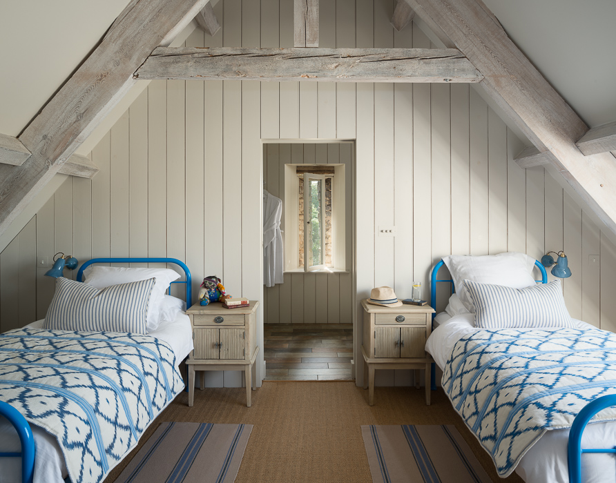 twin bedroom with blue details
