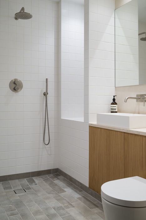 home photography of white bathroom with wooden detailing