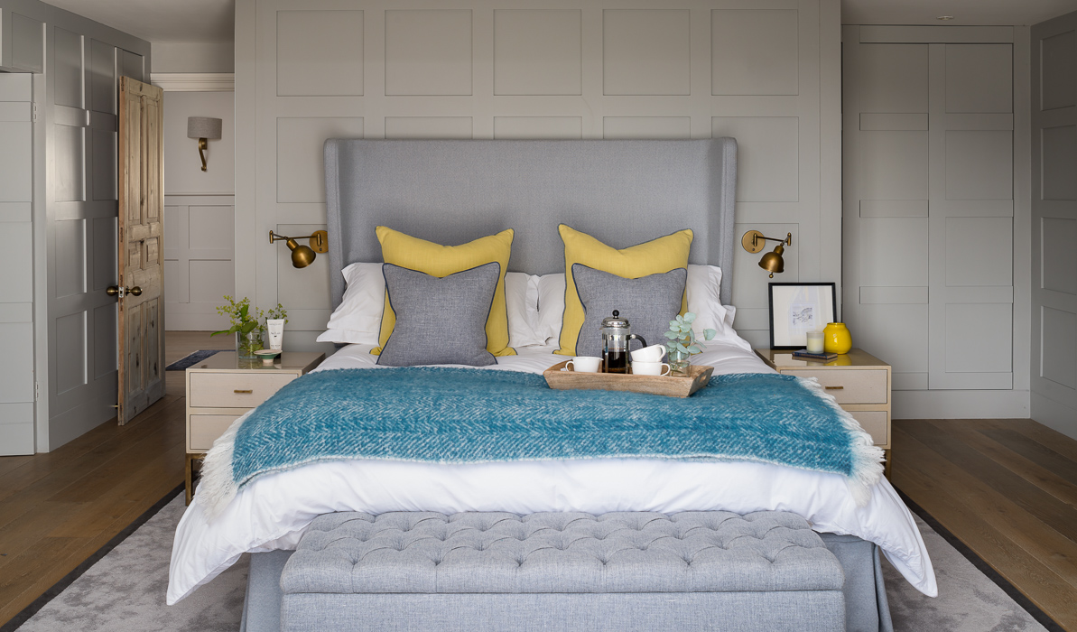 country styled bedroom with grey and mustard details