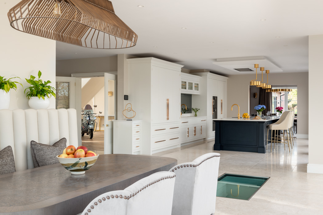 side angle of harriet hughes design modern white kitchen