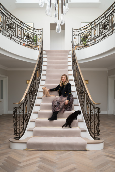 harriet hughes portrait on grand staircase with cats