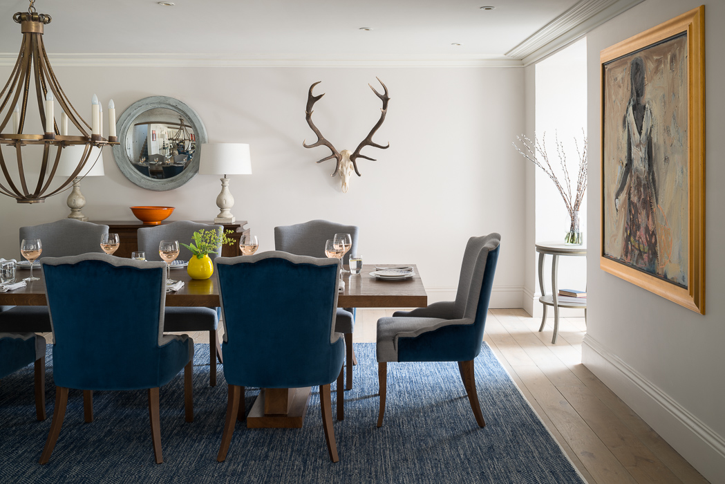 blue dining table with deer antlers