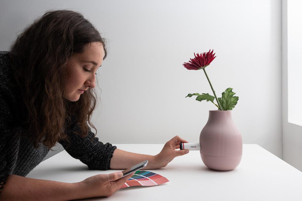 woman using data color colour reader