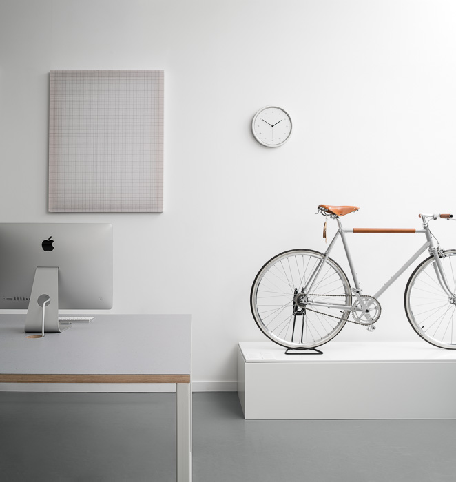 white interior instrmnt with bike and mac computer