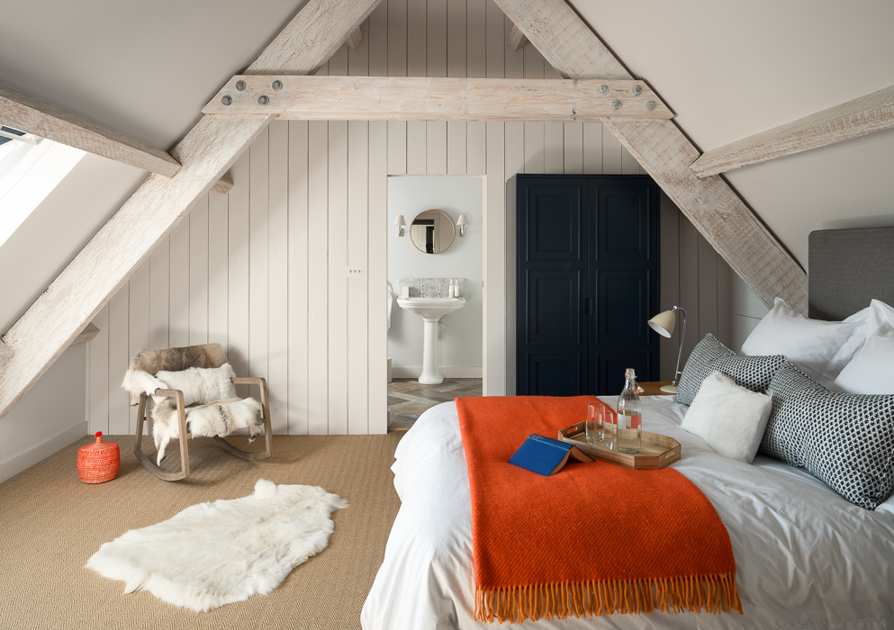 wooden bedroom with orange details