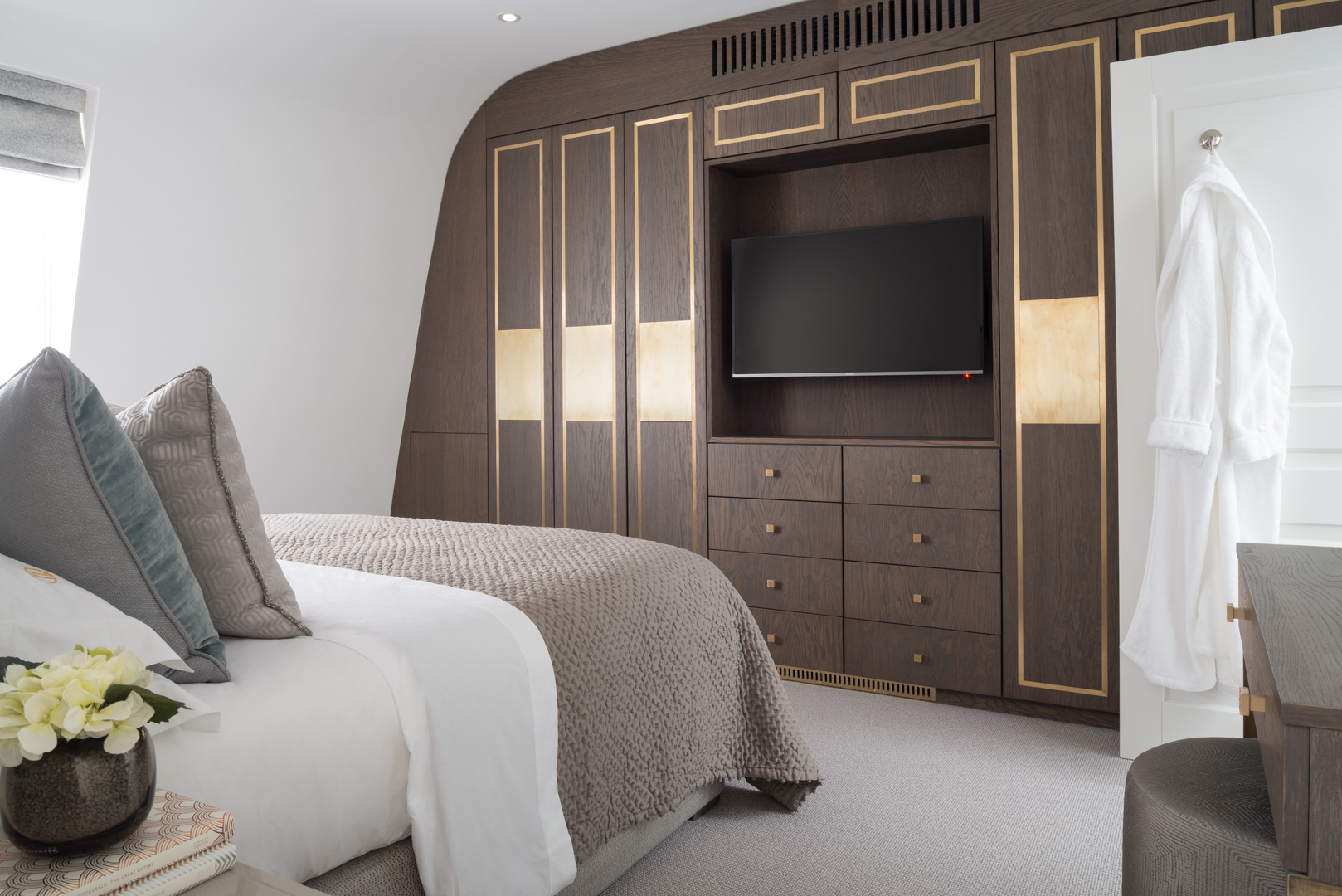property awards zac and zac winner bedroom with brown wooden detail