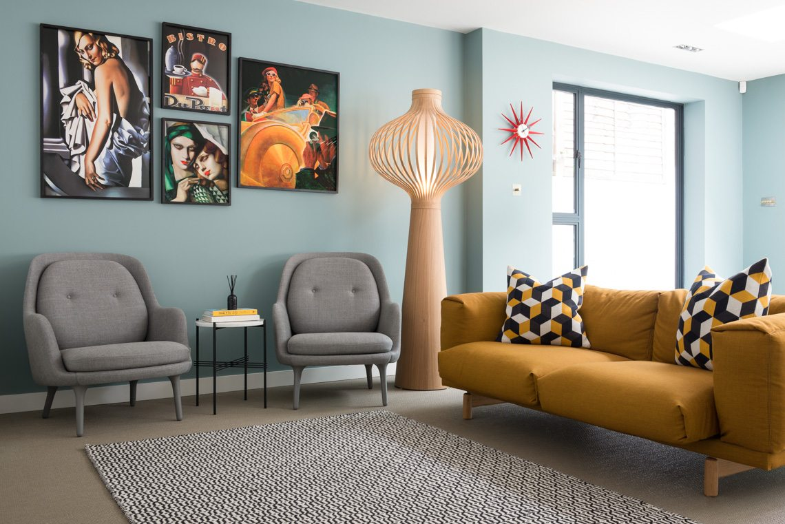 mustard couch with geometric cushions