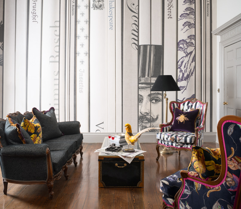 bold livingroom with black and white patterned wallpaper