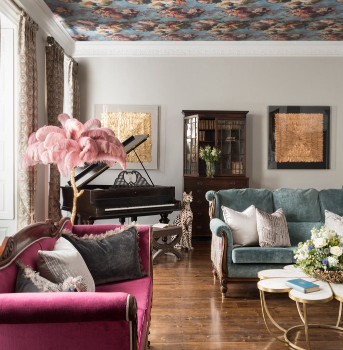 livingroom with painted ceiling and pink couch