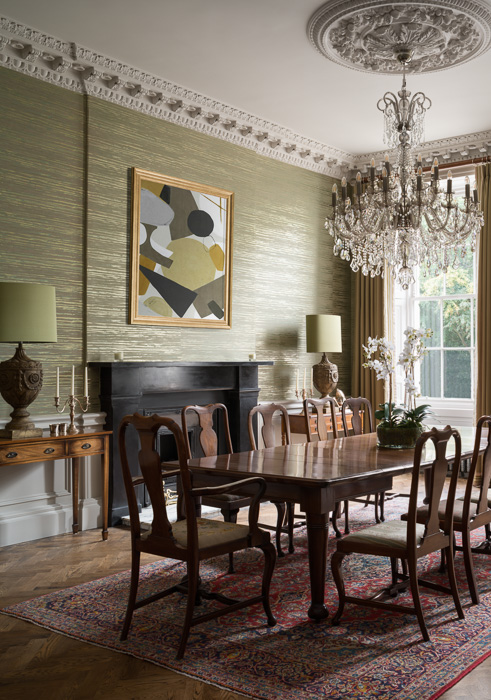 golden interior with brown wooden table malcolm duffin design